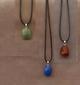Set van 3 edelstenen  met hanger naar keuze. AKTIE